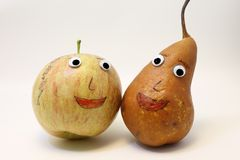 Pair of fruits: Apple and PEAR with big eyes Royalty Free Stock Images