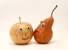 Pair of fruits apple and PEAR with eyes Stock Photos
