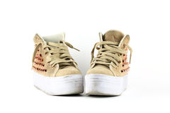 Pair of funky used sneakers shoes Stock Images