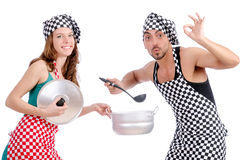 Pair of funny cooks. On white stock images