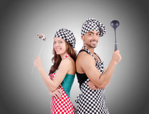 Pair of funny cooks against gradient Royalty Free Stock Images