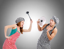 Pair of funny cooks against gradient Stock Photos