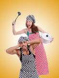 Pair of funny cooks against gradient Royalty Free Stock Photos