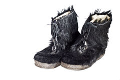 Pair of furry winter boots. A pair of extra-warm winter boots isolated on white Stock Photography