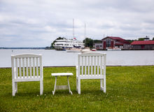 Pair of garden chairs by Chesapeake bay Royalty Free Stock Images