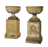 Pair garden terracotta old antique urns on plynths Royalty Free Stock Image