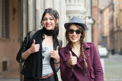 Pair of girlfriends on holiday in Bologna. Couple of girlfriends in Bologna holiday are photographed Stock Photos