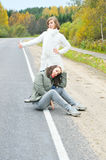 Pair girls on road Royalty Free Stock Images