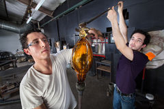 Students Working Together on Glass Art Royalty Free Stock Photo