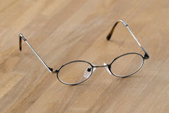 Pair of glasses. On wooden table Stock Image