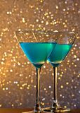 A pair of glasses of blue cocktail on bar table Royalty Free Stock Image
