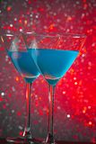 A pair of glasses of blue cocktail on table Royalty Free Stock Images