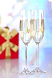Pair glasses of champagne and present box Royalty Free Stock Images
