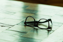 Pair of glasses on a checkered table Stock Images