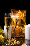 Pair of Glasses Filled with Sparkling Champagne. Festive Still Life - Pair of Glasses Filled with Sparkling Champagne in front of Black Background with Gold Royalty Free Stock Photos