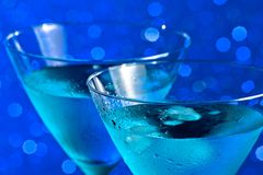 A pair of glasses of  fresh blue cocktail with ice Royalty Free Stock Photo