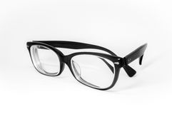 Pair of glasses half folded stock photography