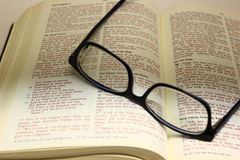 Pair of Glasses on an Open Bible. Bible open to the lord's prayer with a pair of glasses on the page Royalty Free Stock Images