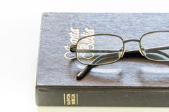 Pair of Glasses over a Holy Bible Royalty Free Stock Photography