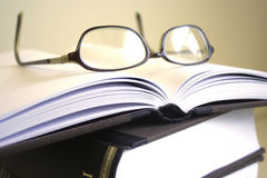 Pair of glasses resting on ope Stock Photography