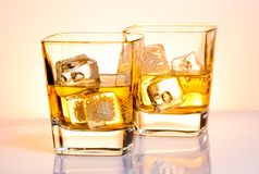 A pair of glasses of whiskey with ice Royalty Free Stock Photography
