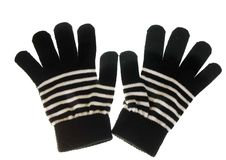 A pair of gloves, black striped with white Stock Photo