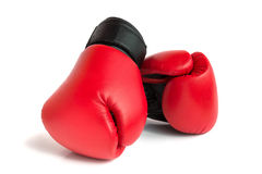 A pair of gloves for boxing. A pair of red gloves for boxing on a white background Stock Photo