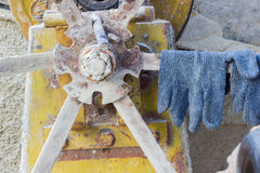 Pair of gloves on the cement mixer in the construction site, hor. Izontal photo Royalty Free Stock Photography