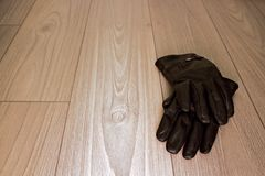 Pair of gloves on floor Royalty Free Stock Photos
