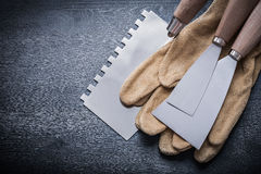 Pair gloves paint scrapers putty knife Stock Image