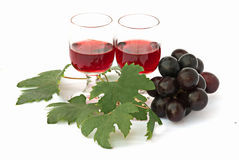 Pair of goblets with wine and grapes. Isolated on white background Royalty Free Stock Photo