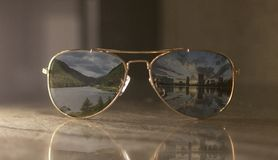 A pair of gold metal and brown lens classic aviator royalty free stock photo