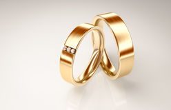 Pair of gold rings with small diamonds for lovers Royalty Free Stock Images