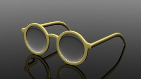 Pair of gold  round-lens eyeglasses Royalty Free Stock Image