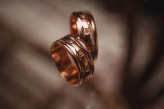 Pair of gold wedding rings  on dark background Royalty Free Stock Images