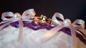 Pair of gold wedding rings with diamond Stock Images