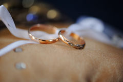 Pair of gold wedding rings on a pillow Royalty Free Stock Photography