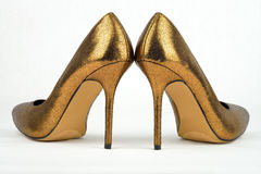 Pair of golden colored High Heel Stock Images
