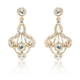 Pair of golden diamond earrings isolated on white Royalty Free Stock Photography