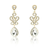 Pair of golden diamond earrings isolated on white Royalty Free Stock Photos