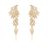 Pair of golden diamond earrings isolated on white Stock Photography