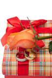 Pair of golden rings with orange rose on the red gift box with r Stock Photos