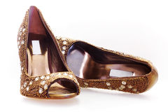 Pair of golden shoes Royalty Free Stock Images