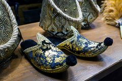 Pair of golden shoes royalty free stock photos