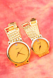 Pair of golden watch Stock Photography