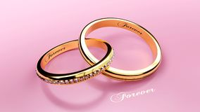 Pair of golden wedding rings connected together forever with carved love words that symbolize love and eternal relationship. Joined golden wedding rings with Stock Photo