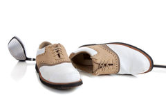 Pair of Golfing shoes and a Golf club. A pair of golfing shoes and a golf club on a white background with copy space stock images