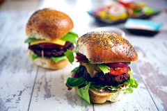 A pair of gourmet burgers Stock Photography