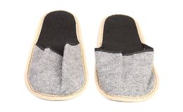 Pair of gray slippers. Stock Photos