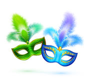 Pair of green and blue vector masks isolated on Royalty Free Stock Photo